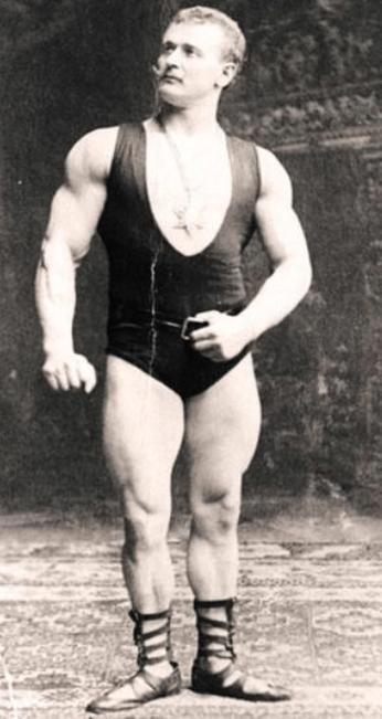 Eugen Sandow posing in sandals and a singlet